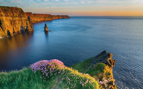 Ireland Irish world famous tourist attraction in County Clare. The Cliffs of Moher West coast of Ireland. Epic Irish Landscape and Seascape along the wild atlantic way. Beautiful scenic nature from Ireland.